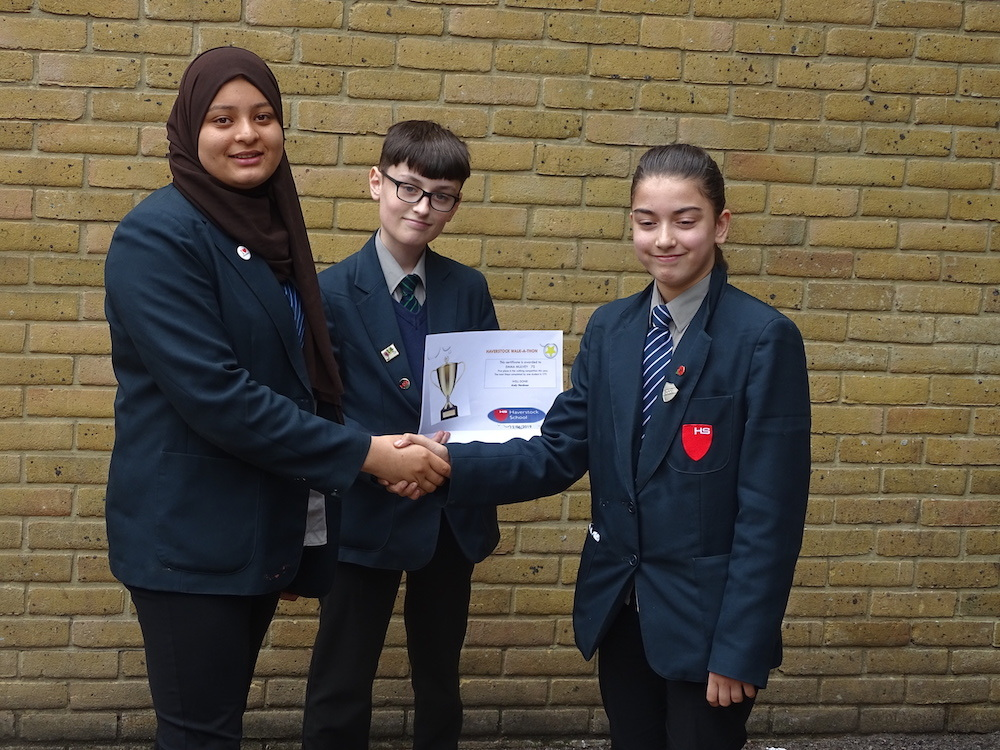 Haverstock school camden youth travel ambassadors congratulate walk a thon winner may 2019