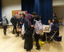 Haverstock school camden science fair guests taking an interest