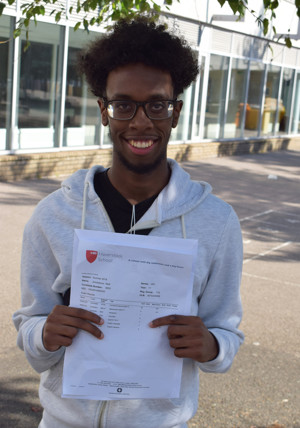 Haverstock School student Ahmednour celebrates his GCSE results, August 2019