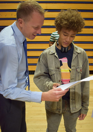 Haverstock headteacher James Hadley celebrates the school's BEST EVER GCSE results with a successful student, August 2019