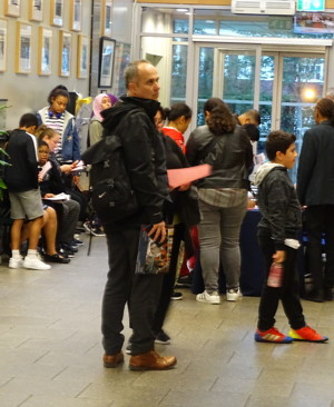Haverstock secondary school camden open evening for year 7 admissions families arriving in school reception area october 2019