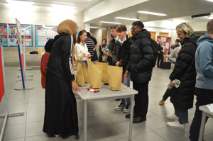 Haverstock sixth form camden london open evening 2019 students visit the display stalls to discuss sixth form life in camden and a level subjects