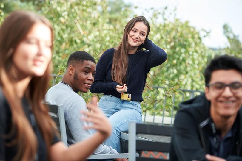 Sixth Form Students on outdoor benches 2019