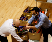 Staff supervising packing